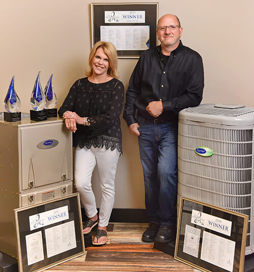 Bill and Peg Next to Carrier Unit and Carrier Cooling Awards